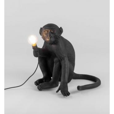 Lampe singe assis noir